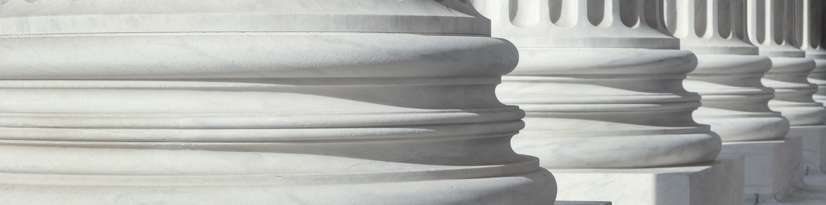 Close-up view of white column pillars.